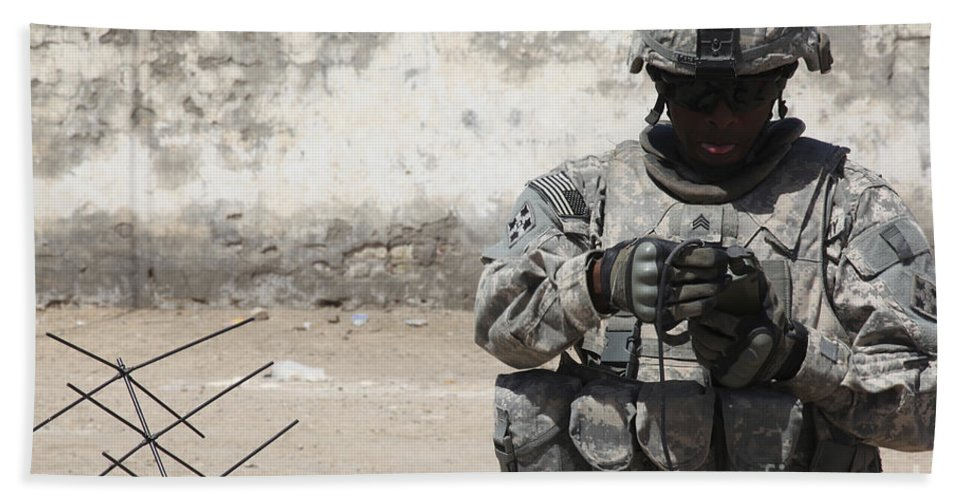 Patrol Hand Towel featuring the photograph A U.s. Soldier Tests A Tactical by Stocktrek Images