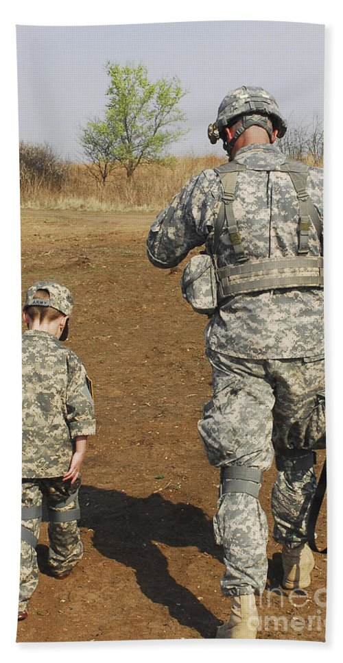 Boys Hand Towel featuring the photograph A Young Boy Joins His Squad Leader by Stocktrek Images