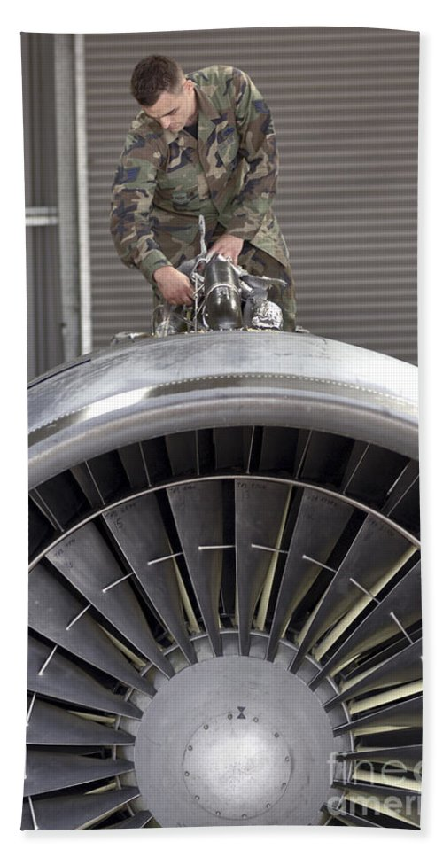 Expertise Hand Towel featuring the photograph Airman Checks Components Atop A C-5 by Stocktrek Images