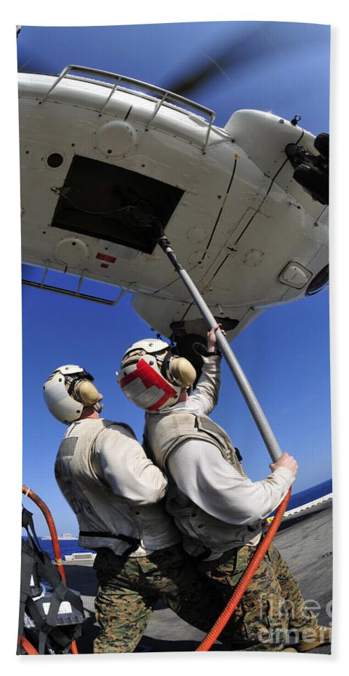 Connection Hand Towel featuring the photograph Airmen Attach Pallet Rigs To An Sa-330j by Stocktrek Images