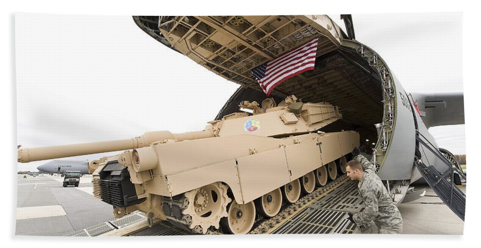 Tank Hand Towel featuring the photograph Airmen Load A Tank Into A C-5m Super by Stocktrek Images
