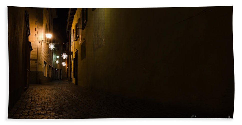 Alley Bath Towel featuring the photograph Alley In Night With Lights by Mats Silvan