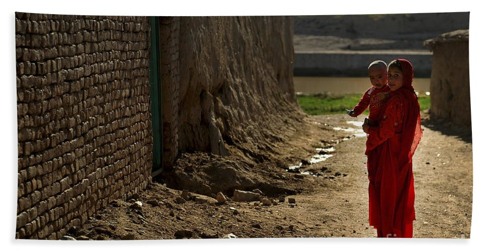 Qalat Hand Towel featuring the photograph An Afghan Girl Carries Her Little by Stocktrek Images