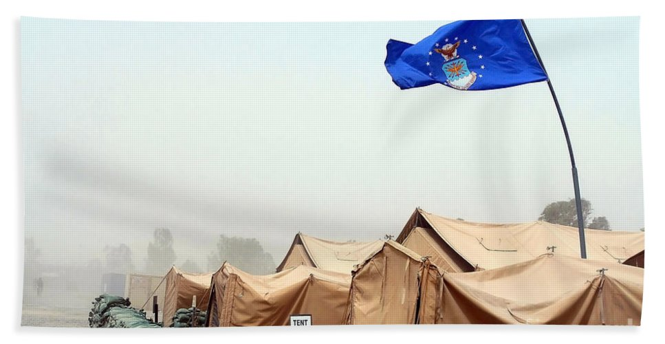 Horizontal Bath Sheet featuring the photograph An Air Force Flag In Tent City Waves by Stocktrek Images