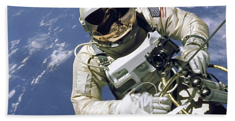 Color Image Bath Sheet featuring the photograph An Astronaut Floats And Maneuvers by Stocktrek Images