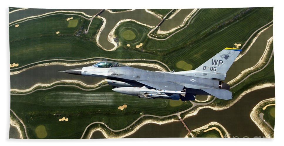 Color Image Bath Sheet featuring the photograph An F-16 Fighting Falcon Flies Near Base by Stocktrek Images