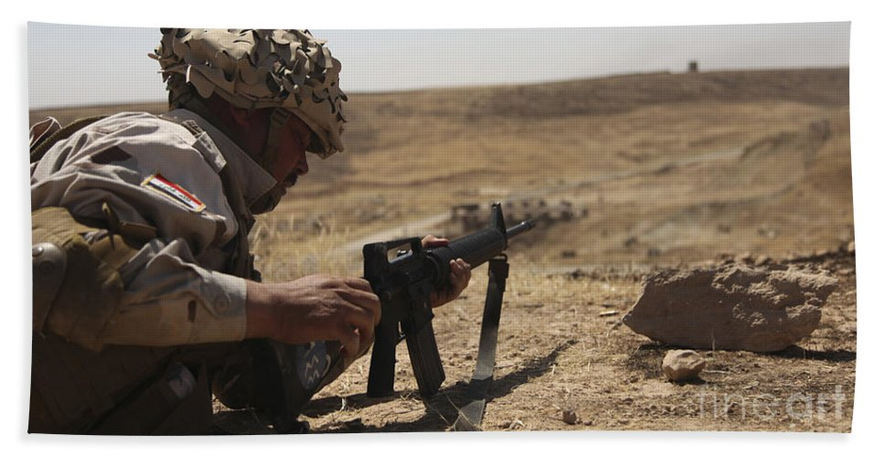 Guzlani Warrior Training Center Hand Towel featuring the photograph An Iraqi Army Soldier Prepares To Fire by Stocktrek Images