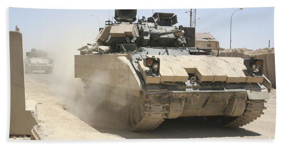 Army Hand Towel featuring the photograph An M2 Bradley Fighting Vehicle Patrols by Stocktrek Images
