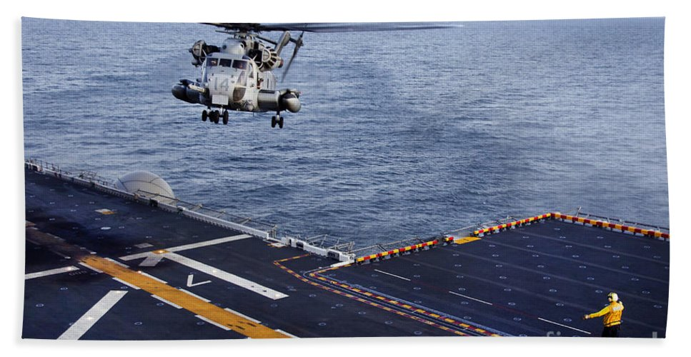 Pacific Ocean Hand Towel featuring the photograph An Mh-53e Sea Dragon Prepares To Land by Stocktrek Images