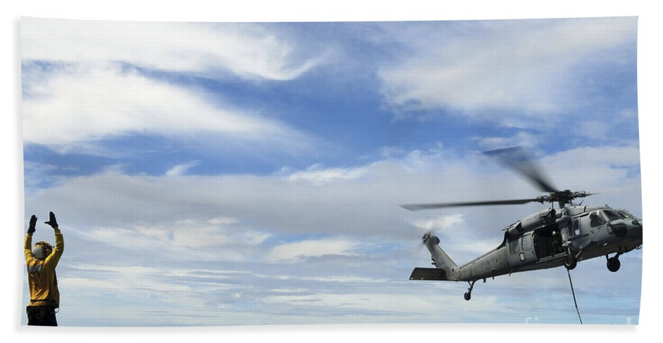 Usns Charles Drew Hand Towel featuring the photograph An Mh-60s Sea Hawk Lifts A Pallet by Stocktrek Images