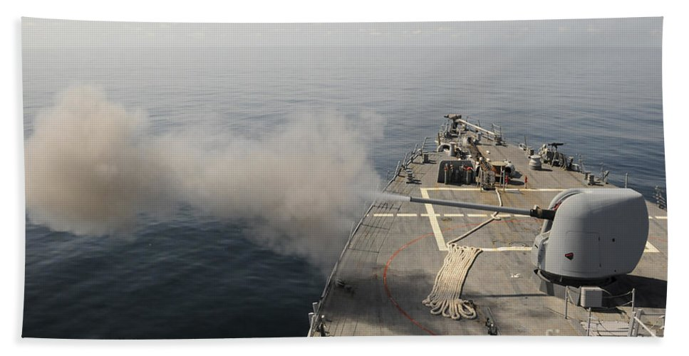 Guided Missile Destroyers Hand Towel featuring the photograph An Mk-45 Lightweight Gun Is Fired by Stocktrek Images