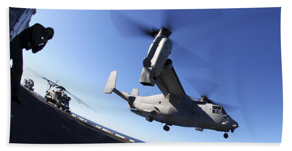 Warship Hand Towel featuring the photograph An Mv-22 Osprey Lands Aboard The Uss by Stocktrek Images