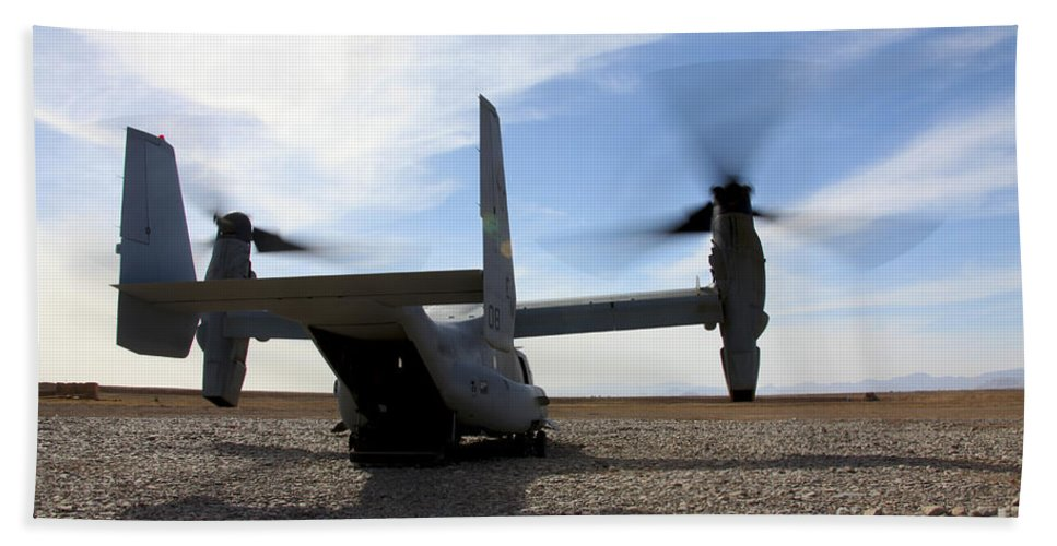Mv-22 Hand Towel featuring the photograph An Mv-22 Osprey Sits Outside A Forward by Stocktrek Images