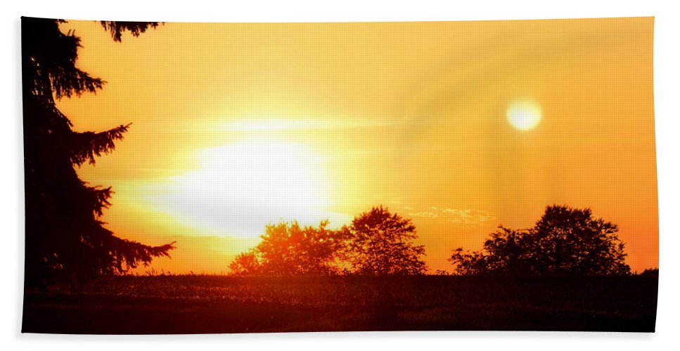 Arbor Day Hand Towel featuring the photograph Photograph Of The White Hot Sun On An Orange Horizon With Lens Flare by Angela Rath