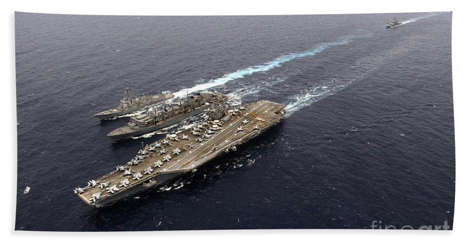 Carrier Strike Group Hand Towel featuring the photograph An Underway Replenishment With Ships by Stocktrek Images