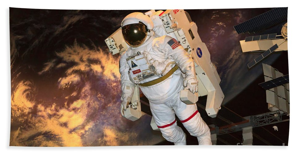 Astronaut Bath Sheet featuring the photograph Astronaut In A Space Suit by Louise Heusinkveld