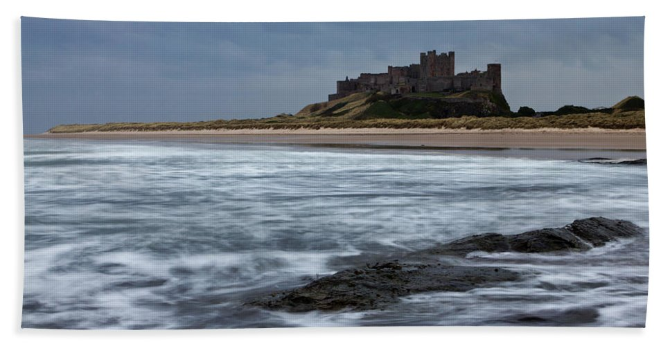 Bamburgh Hand Towel featuring the photograph Bamburgh Castle by David Pringle