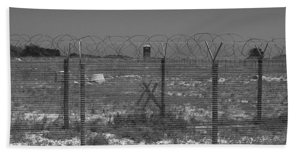Robben Island Hand Towel featuring the photograph Barbed Wire Fence by Aidan Moran