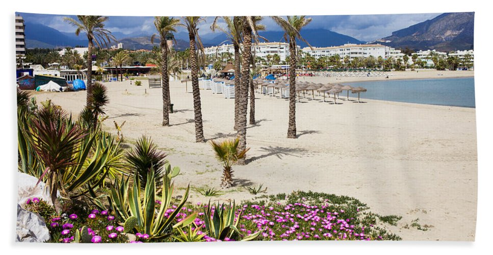 Beach Hand Towel featuring the photograph Beach In Puerto Banus by Artur Bogacki