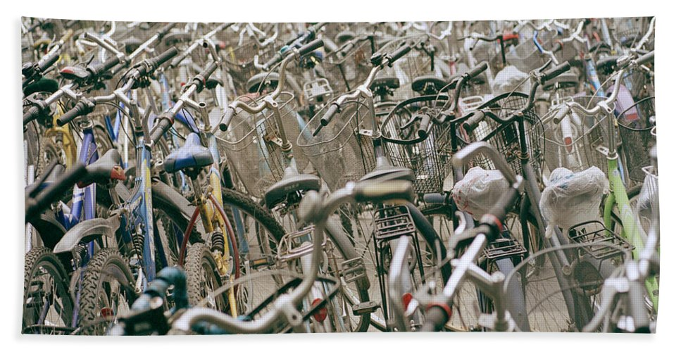 Cultural Bath Sheet featuring the photograph Bicycle Park In Beijing In China by Shaun Higson