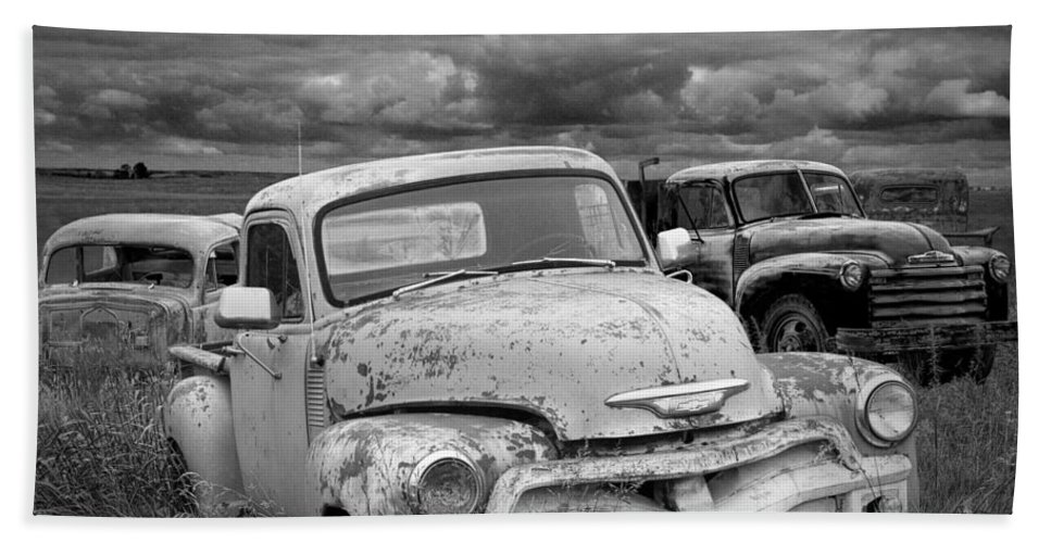 Art Bath Sheet featuring the photograph Black And White Photograph Of A Junk Yard With Vintage Auto Bodies by Randall Nyhof