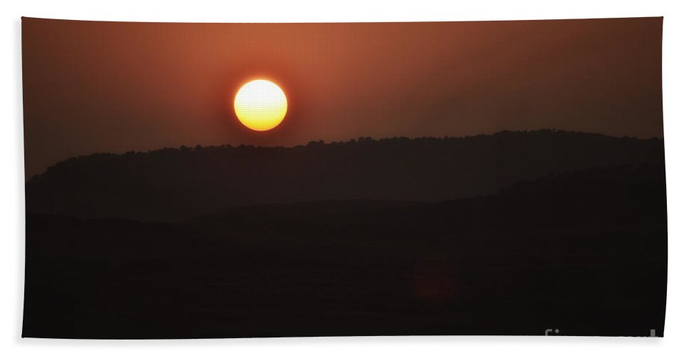 Wyoming Hand Towel featuring the photograph Bloody Sun by Donna Greene