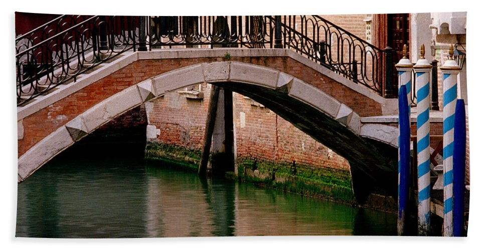 Venice Hand Towel featuring the photograph Bridge And Striped Poles Over A Canal In Venice by Greg Matchick