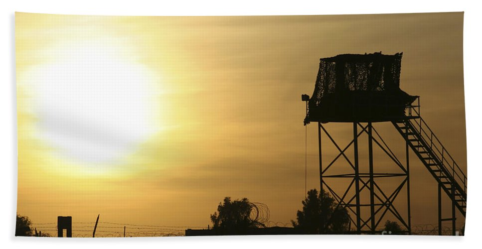 Camp Warhorse Bath Sheet featuring the photograph Camp Warhorse Guard Tower At Sunset by Terry Moore