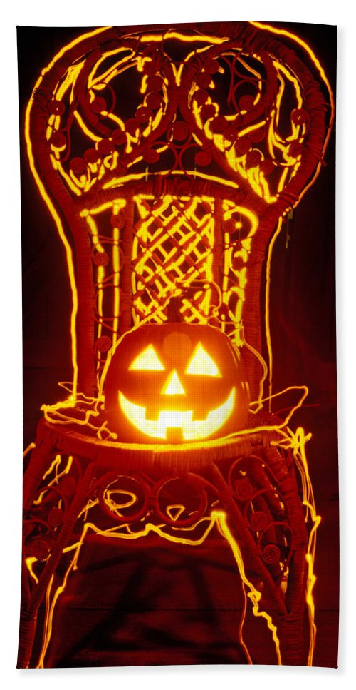 Pumpkin Bath Sheet featuring the photograph Carved Smiling Pumpkin On Chair by Garry Gay
