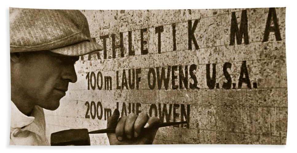 Jesse Bath Sheet featuring the photograph Carving The Name Of Jesse Owens Into The Champions Plinth At The 1936 Summer Olympics In Berlin by American School