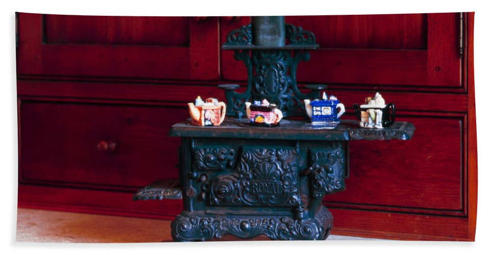 Miniature Cast Iron Stove Hand Towel featuring the photograph Cast Iron Stove With Teapots by Sally Weigand