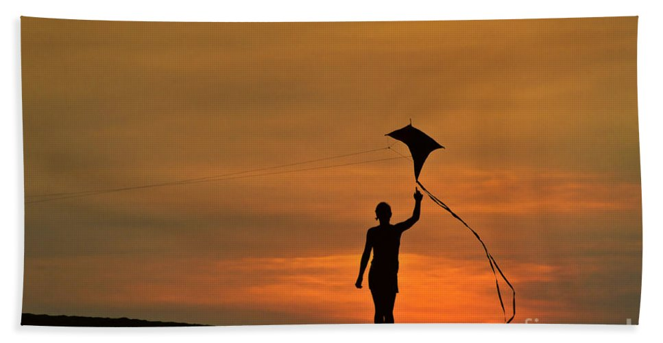 Child Bath Sheet featuring the photograph Child Flying A Kite by John Greim
