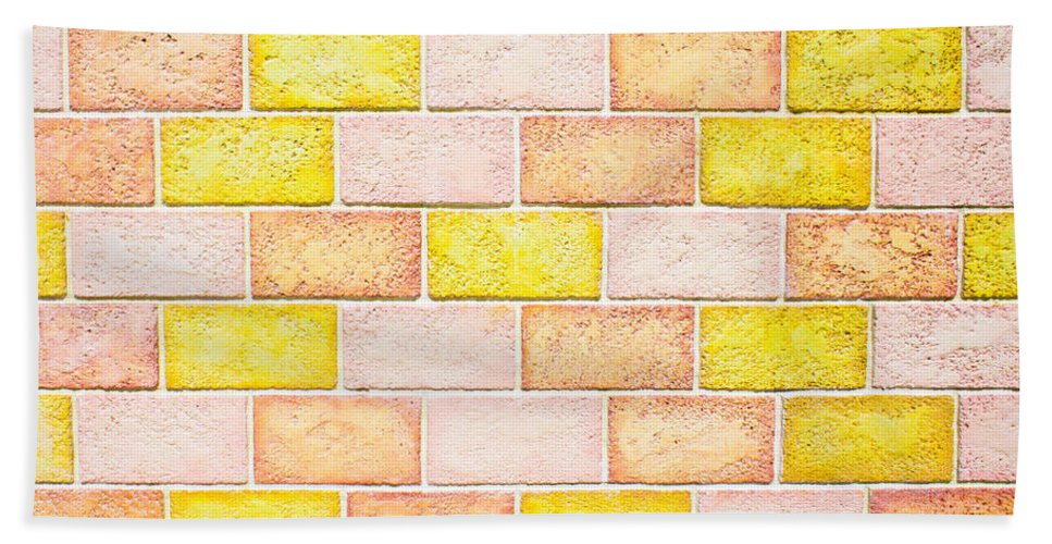 Architecture Hand Towel featuring the photograph Colorful Brick Wall by Tom Gowanlock
