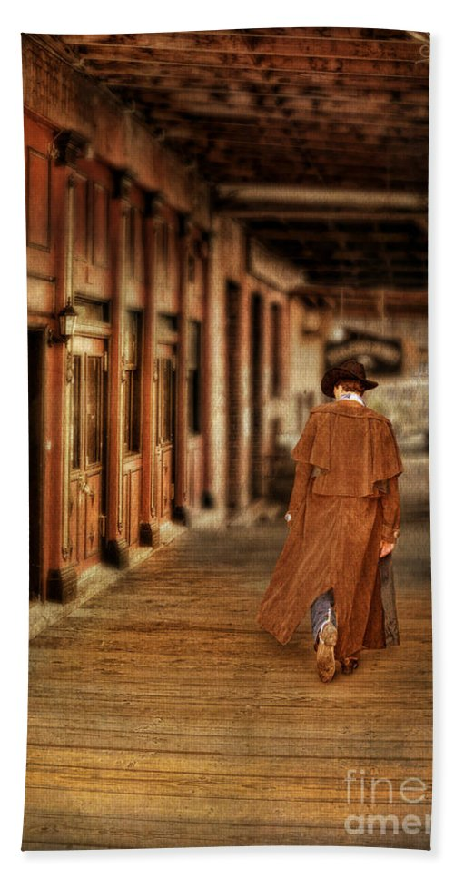 Cowboy Boots Bath Towel featuring the photograph Cowboy In Old West Town by Jill Battaglia