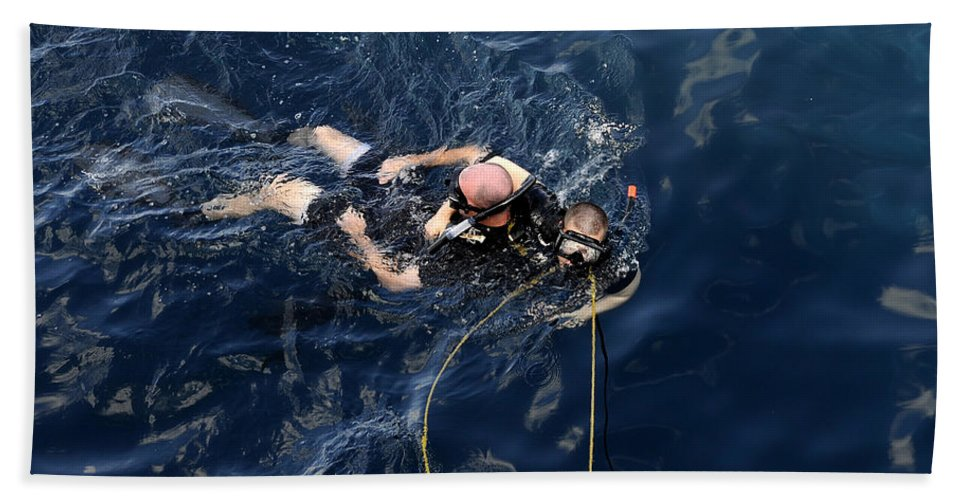 Diving Mask Hand Towel featuring the photograph Damage Controlman Performs Training by Stocktrek Images