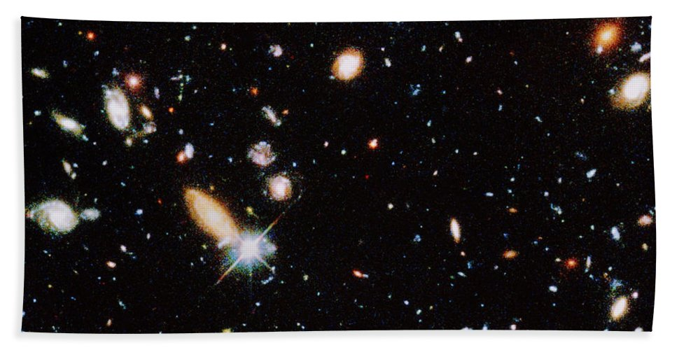 Galaxy Hand Towel featuring the photograph Distant Galaxies by STScI/NASA/Science Source