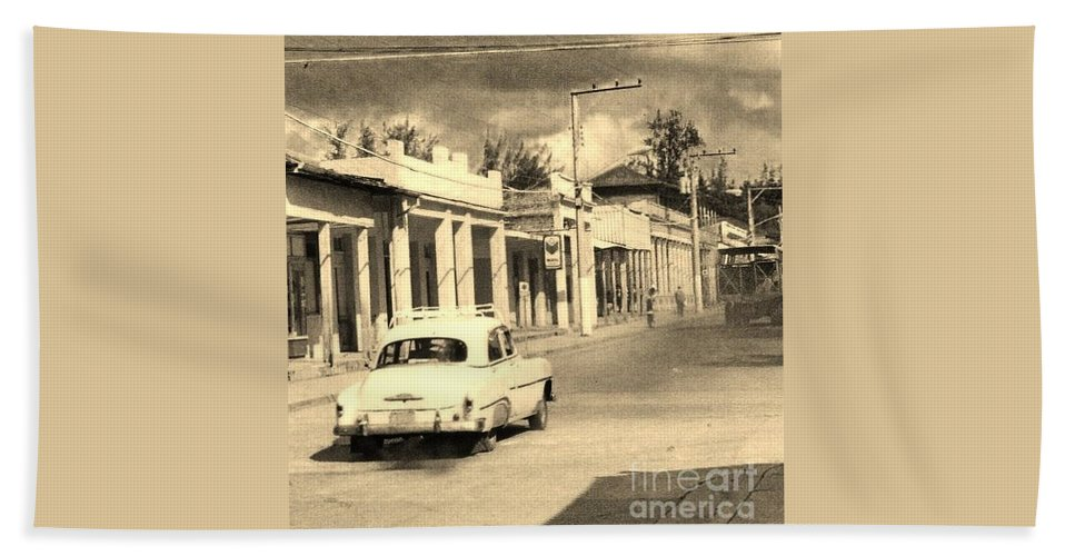 Car Hand Towel featuring the photograph Dusty Old Town by John Malone