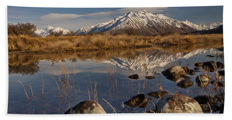 Hhh Bath Towel featuring the photograph Erwhon Station Reflection In Branch by Colin Monteath