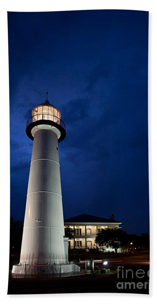 Biloxi Bath Sheet featuring the photograph Evening Lighthouse by Joan McCool