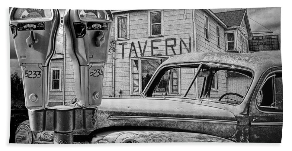 Art Bath Sheet featuring the photograph Expired A Black And White Photograph Of A Tavern Parking Meters And Vintage Junk Auto by Randall Nyhof