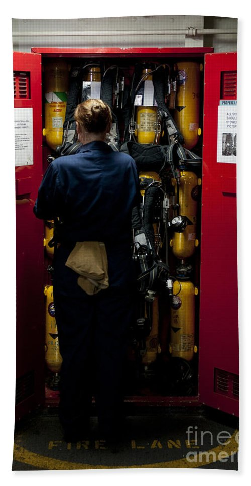 Breathing Apparatus Hand Towel featuring the photograph Fireman Stows A Self-contained by Stocktrek Images