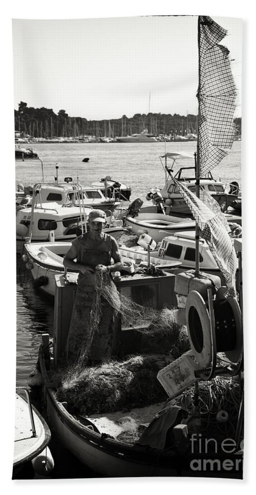 Fisherman Hand Towel featuring the photograph Fisherman by Madeline Ellis