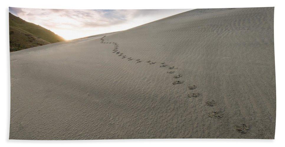 Adventure Bath Sheet featuring the photograph Footprints In Sand by U Schade
