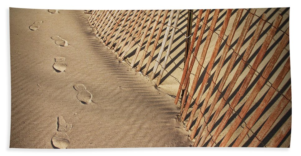 Art Bath Sheet featuring the photograph Footprints On The Beach Along A Fence by Randall Nyhof