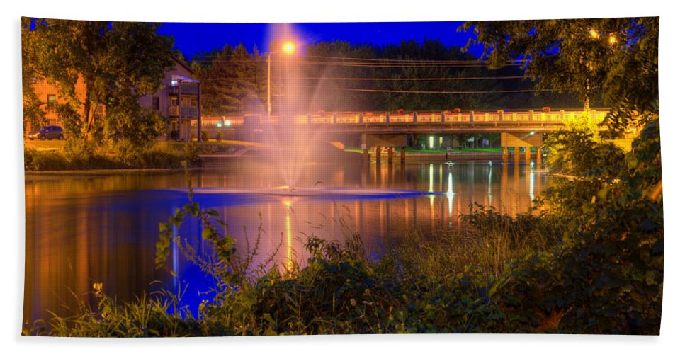Acrylic Prints; Aluminum Prints; Canvas Prints; Digital; Digital Art; Framed Prints; Greeting Cards; John Herzog; Metal Prints; Photo; Photograph; Photography; Posters; Prints; Xdop; Canada; Napanee; Ontario; Night; Night Time; Night_time; Night-time; Outdoor; Outdoors; Outside; color Bath Sheet featuring the photograph Fountain And Bridge At Night by John Herzog
