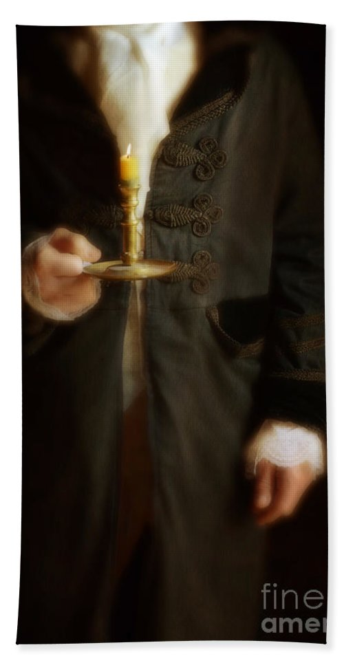Gentleman Bath Sheet featuring the photograph Gentleman In Vintage Clothing Holding A Candlestick by Jill Battaglia