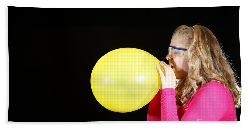 Person Hand Towel featuring the photograph Girl Inflating Balloon by Ted Kinsman