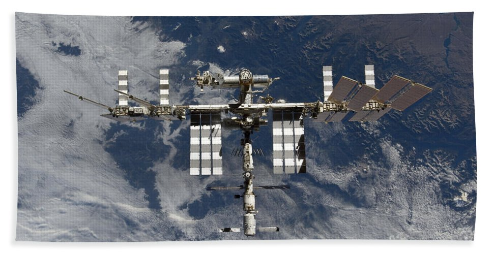 View From Space Bath Sheet featuring the photograph International Space Station Backgropped by Stocktrek Images