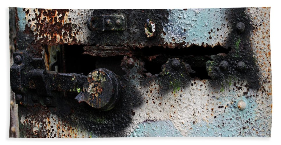 Rust Art Hand Towel featuring the photograph Iron Door Rusted Through by Marie Jamieson