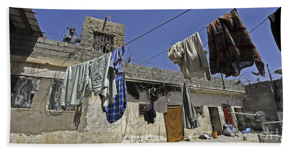 Operation Enduring Freedom Hand Towel featuring the photograph Laundry Hangs In The Courtyard by Stocktrek Images